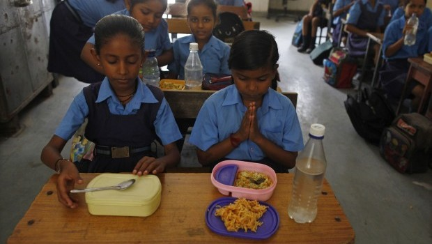 India to probe school meal scheme after 23 children die