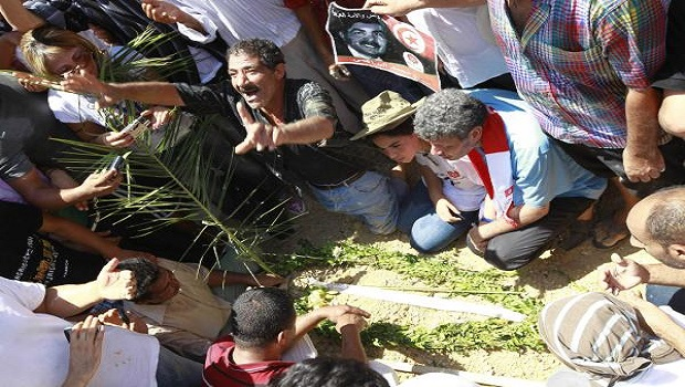 Slain Tunisian opposition figure laid to rest