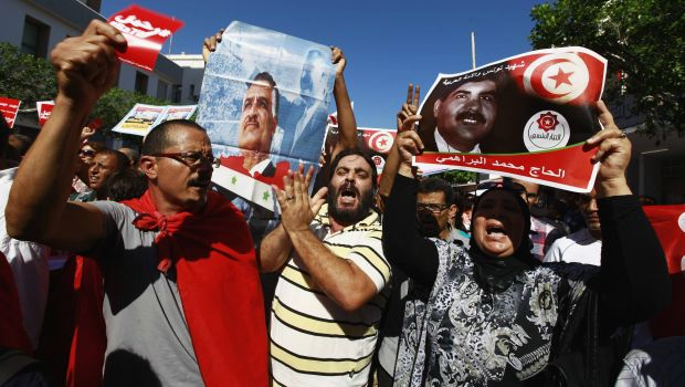 Tunisia's ruling Islamists accept plan to step down