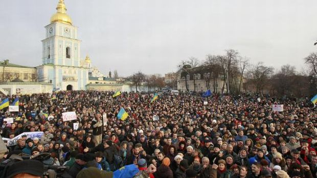 Ukrainian demonstrators converge outside monastery