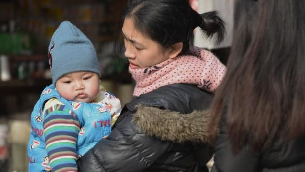 China formalizes easing of one-child policy
