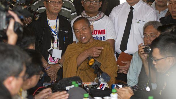 Thai election body urges vote delay, army stays neutral