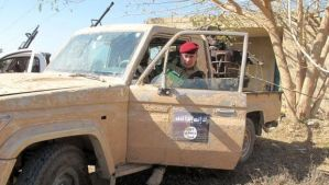 An Iraqi soldier sits in a vehicle that was seized from anti-government fighters affiliated to the Al-Qaeda Islamist organization during a military operation against them on February 8, 2014, in the city of Ramadi, west of the capital Baghdad in the Anbar province. (AFP Photo/Azhar Shallal)