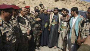 Abdul-Qader Hilal, center, mayor of the Yemeni capital Sanaa, stands with military officials and tribesmen during a mediation between Shi'ite Muslim rebels and Sunni tribesmen in the northern province of Amran, on February 4, 2014. (Reuters/Yemen's Defense Ministry/Handout via Reuters)
