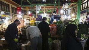 Customers shop at a vegetable store in Tehran, Iran on January 6, 2012. (Reuters/Raheb Homavandi)