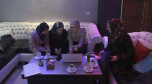 Abeer Abu Ghaith, 29, third from left, the first female high-tech entrepreneur in the West Bank, talks to other Palestinian women in the village of Dura. (AP/Nasser Shiyoukhi)