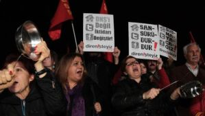 """People shout slogans as they hold placards that read """"stop censorship"""" during a rally against a proposed internet restriction bill, in Ankara, Turkey, on Saturday, January 18, 2014. (AP Photo/Burhan Ozbilici)"""