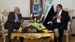 Iraqi Foreign Minister Hoshyar Zebari, right, meets with his Iranian counterpart Mohammad Javad Zarif on January 14, 2014, in Baghdad, Iraq. (AFP Photo/Pool/Khalid Mohammed)