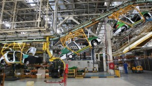 A line of Peugeot 206s on the production line at the Iranian state-run Iran Khodro automobile manufacturing plant near Tehran, Iran, in April 2011. (AP Photo/Vahid Salemi, File)
