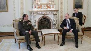 Russian President Vladimir Putin (R) speaks with Egyptian Army chief Field Marshal Abdel Fattah al-Sisi during their meeting at the Novo-Ogaryovo state residence outside Moscow, February 13, 2014. REUTERS/Mihail Metzel/RIA Novosti/Kremlin (RUSSIA - Tags: POLITICS MILITARY) THIS IMAGE HAS BEEN SUPPLIED BY A THIRD PARTY. IT IS DISTRIBUTED, EXACTLY AS RECEIVED BY REUTERS, AS A SERVICE TO CLIENTS