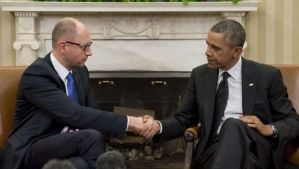 US President Barack Obama and Ukrainian Prime Minister Arseny Yatseniuk shake hands during meetings in the Oval Office of the White House in Washington, DC, on March 12, 2014. (AFP Photo/Saul Loeb)