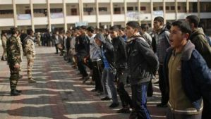 Members of the Palestinian security forces loyal to Hamas conduct a military-style exercise for Palestinian students at a school in Gaza City on January 7, 2014. (Reuters/Mohammed Salem)
