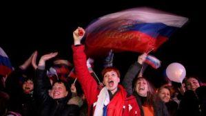 People react after the end of a referendum in Sevastopol, in the Crimea region in Ukraine, on March 16, 2014. (EPA/Zurab Kurtsikidze)