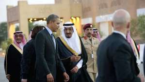 US President Barack Obama (C-L) is greeted by Saudi Crown Prince Salman bin Abdulaziz al-Saud (C-R) upon his arrival at Rawdat Khurayim, the monarch's desert camp 60 miles (35 miles) northeast of Riyadh ahead of a meeting with Saudi King Abdullah, on March 28, 2014. Obama arrived in Riyadh for talks with Saudi King Abdullah as mistrust fuelled by differences over Iran and Syria overshadows a decades-long alliance between their countries. AFP PHOTO / SAUL LOEB