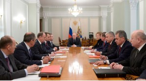Russian President Vladimir Putin, center, chairs a Security Council meeting in the Kremlin in Moscow, Russia, Friday, March 28, 2014. Russia's president says Ukraine could regain some arms and equipment of military units in Crimea that did not switch their loyalty to Russia. (AP Photo/RIA-Novosti, Alexei Nikolsky, Presidential Press Service)