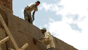 Yemeni laborers repair a damaged part of the wall that surrounds the historical quarter in the Yemeni capital, Sana'a, currently listed as one of the world heritage sites by the United Nations Educational, Scientific and Cultural Organisation (UNESCO), on March 13, 2014. (AFP PHOTO/ MOHAMMED HUWAIS)