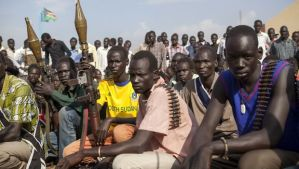 Members of the White Army, a South Sudanese anti-government militia, attend a rally in Nasir on April 14, 2014.(AFP PHOTO / ZACHARIAS ABUBEKER)