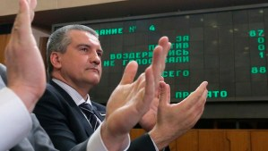 Crimea's Prime Minister Sergei Aksyonov reacts after the constitution of Crimea was approved during a session of the State Council of the Republic of Crimea in Simferopol on April 11, 2014. (REUTERS/Maxim Shemetov)