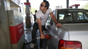 An Iranian man fills his car in a gas station in central Tehran, Iran, on Friday, April 25, 2014. (AP Photo/Vahid Salemi)