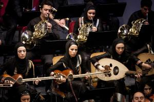 Members of Iran's National Orchestra perform at a concert during the 27th Fadjr International Music Festival in Tehran on February 16, 2012. (Xinhua/Ahmad Halabisaz)
