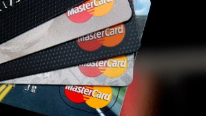 MasterCard credit cards are displayed for a photographer. (AP Photo/Toby Talbot)
