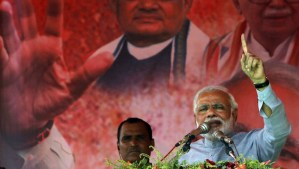 India's main opposition Bharatiya Janata Party's prime ministerial candidate, Narendra Modi, addresses his supporters during a campaign rally at Balasore, 124 miles (200 kilometers) from the eastern Indian city of Bhubaneswar, on April 11, 2014. (AP Photo/Biswaranjan Rout)