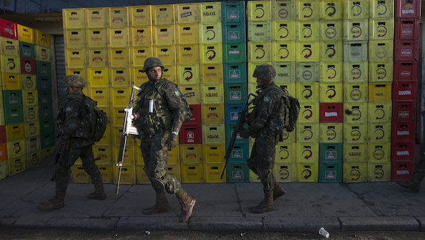 Brazil security forces raid Rio slum before World Cup