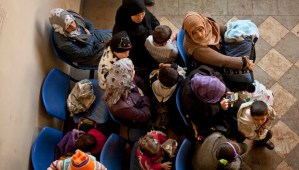 In this Wednesday, December 18, 2013, file photo, Syrian women wait with their children at the UN refugee agency's registration center in Zahleh, in Lebanon's Bekaa Valley. (AP Photo/Maya Alleruzzo, File)
