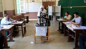 An Egyptian woman casts her ballot during the second day of presidential elections at a polling station in the Heliopolis district of Cairo on May 27, 2014. (EPA/KHALED ELFIQI)