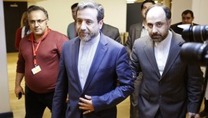 Abbas Araghchi (C), Iran's chief nuclear negotiator, arrives at the Austria Center Vienna after another round of talks between the P5+1 on May 16, 2014. (AFP PHOTO/DIETER NAGL)