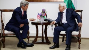 File photo of US Secretary of State John Kerry and Palestinian President Mahmoud Abbas meeting in Ramallah on December 5, 2013. (AP Photo/Mohamad Torokman, Pool, File)