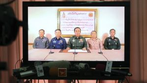 Thai Armed Forces Chiefs are shown on television announcing the military takeover in Bangkok, Thailand, on May 22, 2014. (AP Photo/Apichart Weerawong)