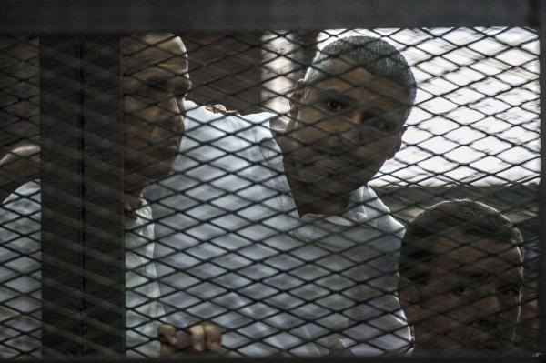Egypt sentences three Al-Jazeera reporters to seven years