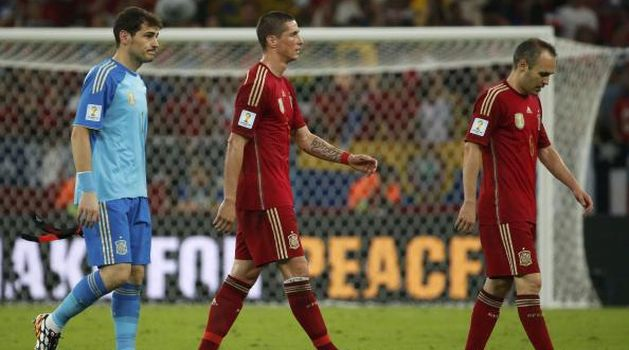 Champions Spain out of World Cup, Dutch march on