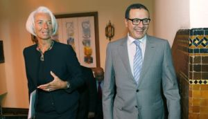 Moroccan Minister of Finance Mohamed Boussaid (R), chats with International Monetary Fund Managing Director Christine Lagarde (L) as they walk before a meeting in the Ministry of Finance in Rabat on May 8, 2014. (AP Photo/Abdeljalil Bounhar)