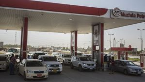 Residents line up to purchase gas at a station in Kirkuk on June 21, 2014. (Asharq Al-Awsat/Hannah Lucinda Smith)