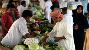 Omanis shop at a market in Muscat on August 11, 2010. (MOHAMMED MAHJOUB/AFP/Getty Images)