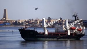 A military helicopter flies above a container ship in the Suez canal near Ismailia port city, northeast of Cairo, on May 2, 2014. (REUTERS/Amr Abdallah Dalsh)