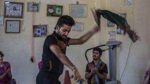 A member of Halparki Kirkuk practices his dance moves. (Hannah Lucinda Smith)