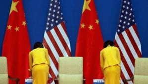 Chinese hostesses prepare tea for US Secretary of State John Kerry and Chinese President Xi Jinping on in Beijing on July 9, 2014. (AP Photo/Andy Wong)