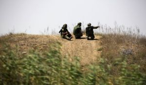 Israeli soldiers patrol near the border with Gaza on July 23, 2014.(REUTERS/Amir Cohen)