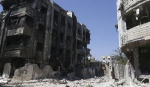 A general view shows damaged buildings in Jobar, a suburb of Damascus, on July 18, 2014. (REUTERS/Bassam Khabieh)