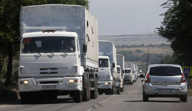 Russian aid convoy drives into Ukraine