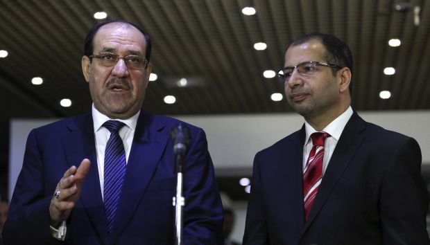 Shi'ite militia kill dozens of Iraqi Sunnis in mosque shooting