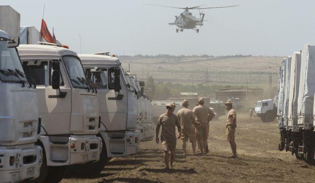 Russian aid convoy checked; military vehicles mass near Ukraine