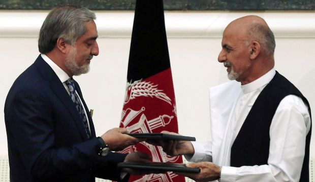 Afghanistan's presidential rivals sign deal for power-sharing government