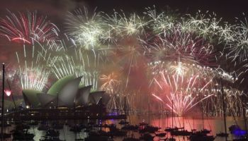 beach parties fireworks world rings in new year