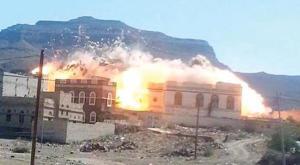 A house set ablaze by Houthi militias