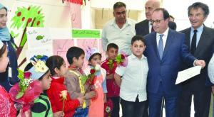 President Hollande met on Sunday Syrian refugees in Dalhamieh camp in the eastern Bekaa region