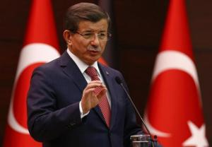 Turkish Prime Minister Davutoglu speaks during a joint news conference